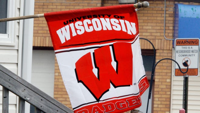 A Badger fan shows their support with a flag along Geele Avenue Thursday April 2, 2015 in Sheboygan.
