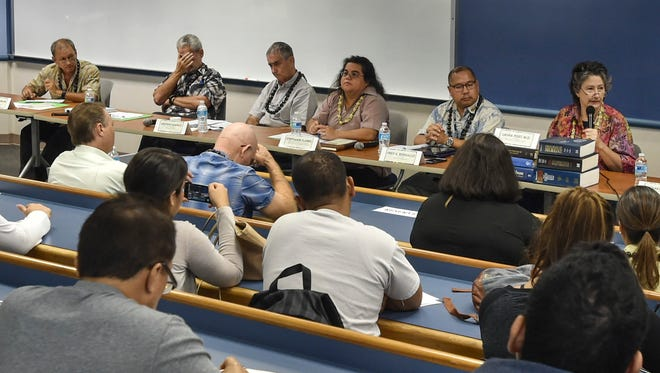 This file photo shows a forum on medical marijuana at the University of Guam .