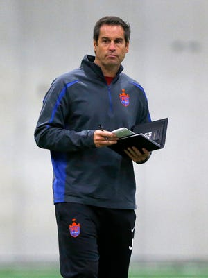 FC Cincinnati head coach John Harkes takes notes as players try out for a place on the team during FC Cincinnati's combine at Wall2Wall in Mason, Ohio, on Thursday, Jan. 28, 2016. FC Cincinnati's inaugural season opens on March 25 at the University of Cincinnati's Nippert Stadium.