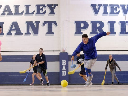 Kids play hockey in Valley View Middle School's gymnasium