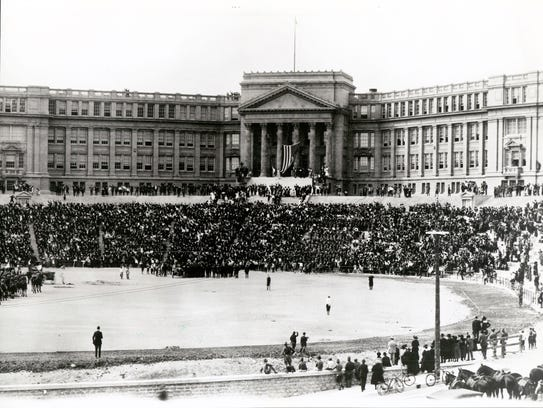 A joyous crowd, led by James A. Dick, pledges allegiance