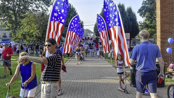 Families make their way down the entryway of Capital University to enjoy the festivities during the 2019 Bexley Fourth of July celebration on the front lawn of Capital University. Because of the COVID-19 coronavirus pandemic, this year's Independence Day celebration will be scaled down to avoid large crowds.
