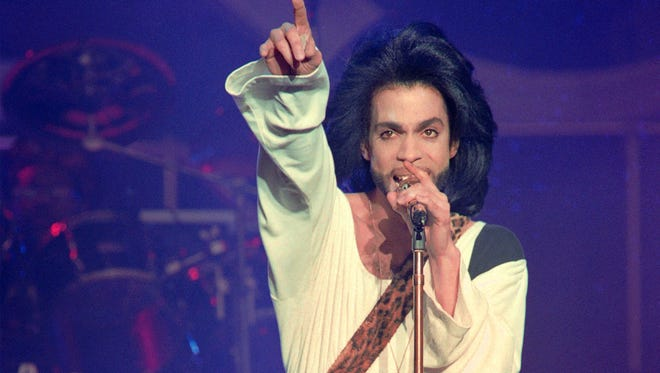Prince, seen here in a 1990 photo, will be honored at an official tribute show on Oct. 13 in his hometown of Minneapolis.