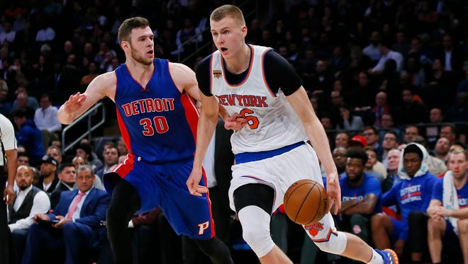 Nov 16, 2016; New York, NY, USA; New York Knicks forward Kristaps Porzingis (6) dribbles the ball in front of Detroit Pistons forward Jon Leuer (30)  during second half at Madison Square Garden. The New York Knicks defeated the Detroit Pistons 105-102. Mandatory Credit: Noah K. Murray-USA TODAY Sports