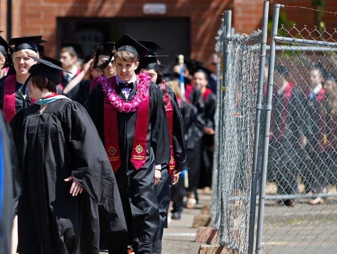 Graduates leave the Sparks Center at the start of the 172nd Willamette University commencement exercises on Sunday, May 11, 2014.