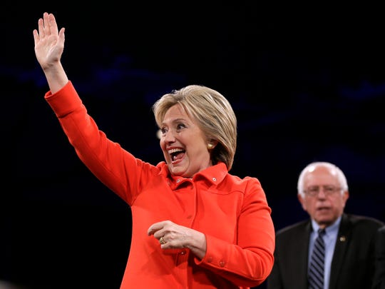 Democratic presidential candidate Hillary Rodham Clinton waves to supporters during the Iowa Democratic Party's Jefferson-Jackson Dinner, Saturday, Oct. 24, 2015, in Des Moines, Iowa.