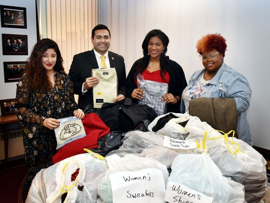 Union County Freeholder Chairman Sergio Granados thanks Crystal Orr and Keyonah Orr of the Urban League of Union County Young Professionals for a donation of business clothing for men and women to the Union County One Stop Center. They were joined by Nathalie Hernandez, coordinator of the Office of Community Engagement and Diversity.