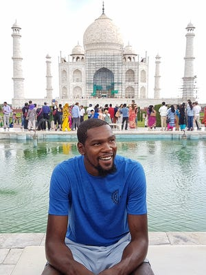 Kevin Durant sits in front of the Taj Mahal during his trip to India.