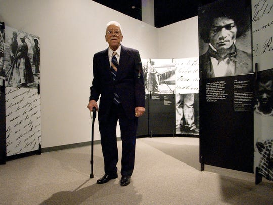 James Cameron stands in the Black Holocaust Museum in  Jan. 28, 2003, in Milwaukee. Cameron, who founded the museum, died June 11, 2006 at the age of 92.