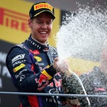 Sebastian Vettel of Germany and Infiniti Red Bull Racing celebrates on the podium after winning the Italian Formula One Grand Prix at Autodromo di Monza on Sept. 8, 2013 in Monza, Italy.