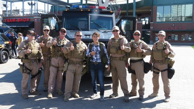 17 year-old Miguel poses with members of RPD SWAT on August 5, 2016.