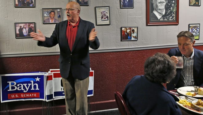 John Gregg, Democratic candidate for governor, and former Sen. Evan Bayh (right) had breakfast at the Kountry Kitchen in Indianapolis at the start of a day of campaigning, Oct. 15, 2016.