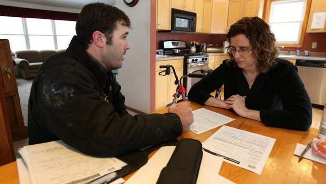 Cory Amos sits down with Jackie Wellman to go over the audit of her West Des Moines home. He talked about adding several inches of insulation to the home's attic. The Wellmans qualified for a rebate from MidAmerican Energy. /
