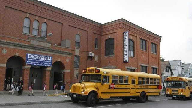 A file photo of students heading for their buses at the end of the school day at Rochester Prep True North Charter School, located at 899 Jay Street in Rochester.