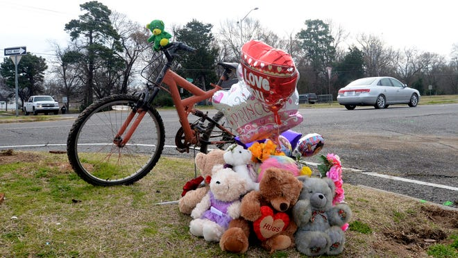 A memorial for 7-year-old De'Asia Henderson appeared at the site of the Youree Drive and East Herndon Street accident that took her life. The man charged in her death, Randy Presentine, had a long history of serious traffic violations.