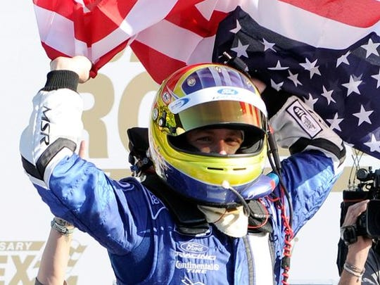 A.J. Allmendinger celebrates in Victory Lane after winning the Rolex 24 at Daytona International Speedway in 2012.