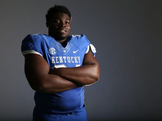 True freshman George Asafo-Adjei is already one of UK's biggest, strongest players. He could start as at right tackle.