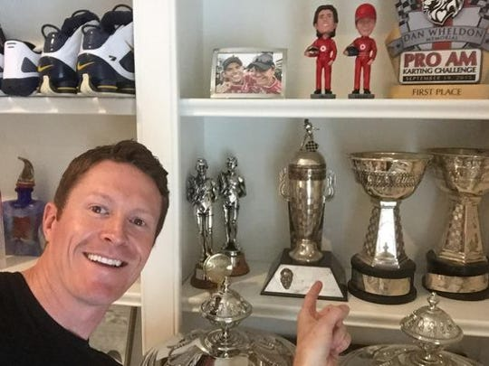 Scott Dixon with his Borg-Warner trophy from the 2008 Indianapolis 500.