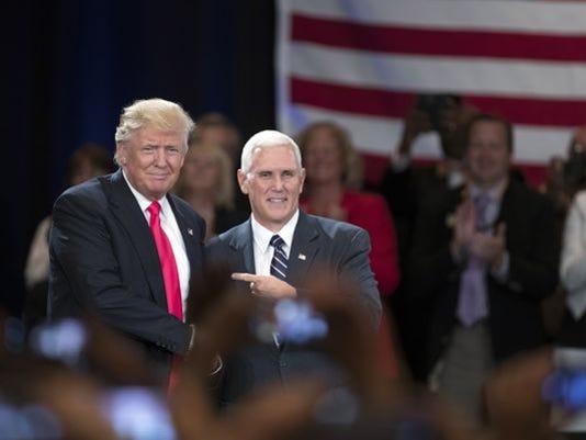 636053102869021373-Pence-and-Trump-in-Roanoke-Va.-on-7-25.JPG