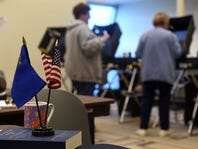 Nevada Democrats and Republicans have flocked to vote early. Neither side is pulling away