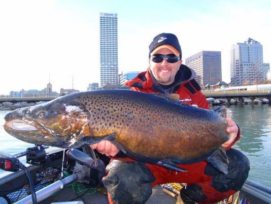 Eric-Haataja-with-brown-trout-in-Milwaukee.jpg