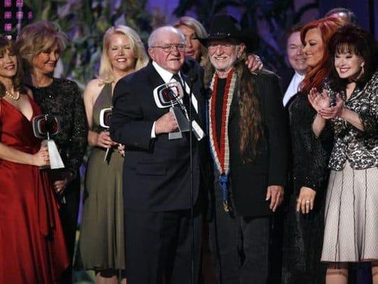 Sam Lovullo (center left)