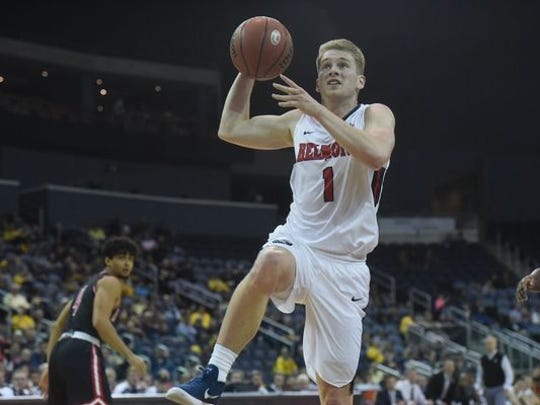 Belmont point guard Austin Luke shoots a layup in the semifinals of the OVC Tournament against Austin Peay.