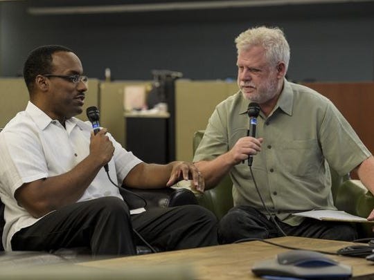 "David Dye, host of NPR's ""World Cafe"" radio program, right, interviews Herman Fuselier, music and entertainment reporter of the Daily Advertiser, in 2014."