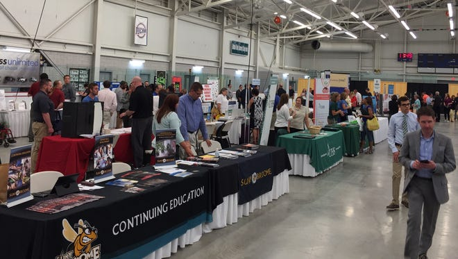 Job-seekers browse from among 63 area employers on Friday during the annual Greater Binghamton Chamber of Commerce Career Fair. The event was held at SUNY Broome Community College.