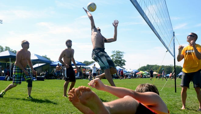 Gage Liberati, of Novi, hits a ball back Sunday, July 26, during the annual Volleygrass volleyball tournament at Port Huron Northern.