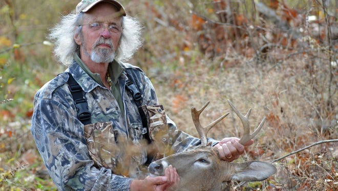 "The author poses with his ""special memory"" buck."