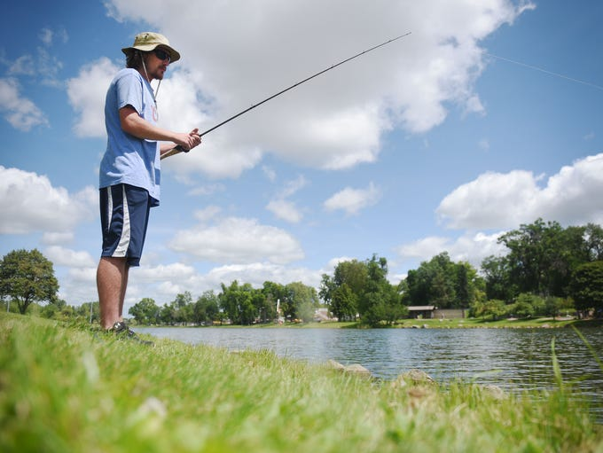 Sam Anderson fishes Covell Lake Thursday, July 26,