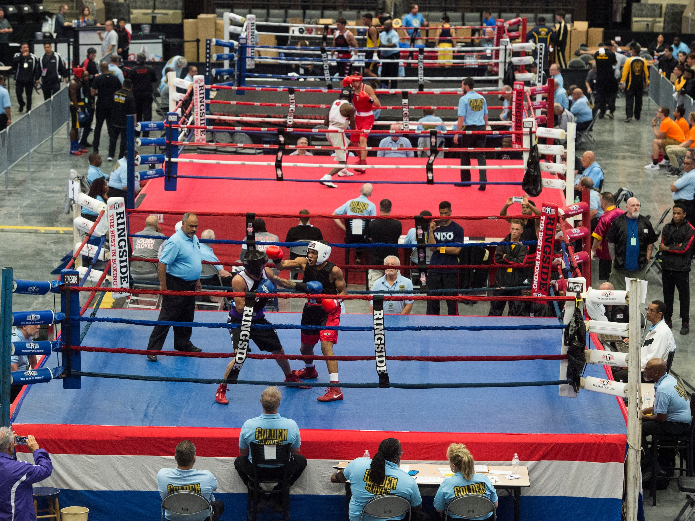 Raymon Henry, front right, fights Cristian De La Rosa in the first round of the 165 lbs division during the National Golden Gloves tournament at the Ralston Arena in Ralston, Neb. on Monday, May 14, 2018. Henry won the fight and lost in the second round to a nationally ranked opponent.