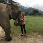 Local student works at elephant preserve in Thailand