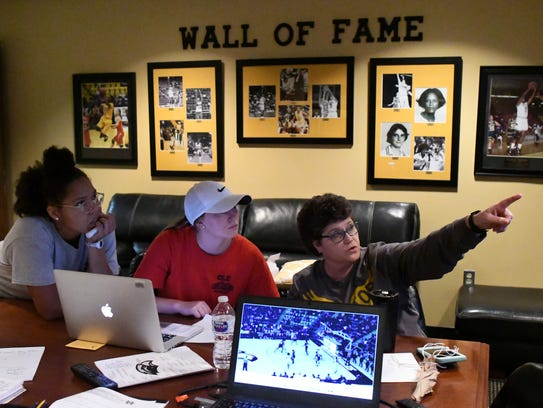 Southern Miss women's basketball coach Joye Lee-McNelis watches film with Lady Eagles Megan Brown, left, and Allie Kennedy.