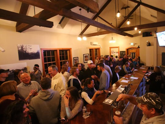 Yorklyn's Dew Point Brewing Co.'s tasting room features exposed wood beams and a changing selection of brews.