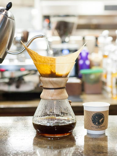 A pour-over coffee gets made Friday afternoon at Dark