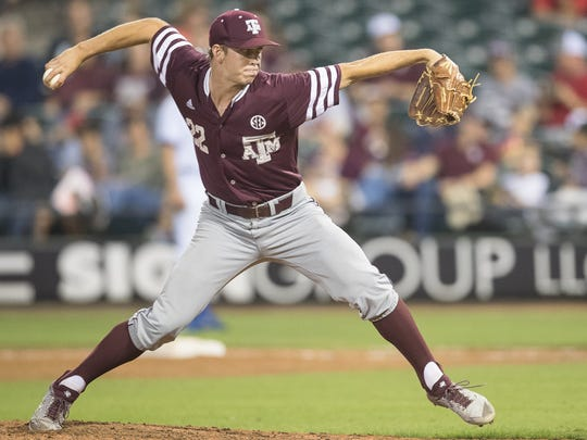 Texas A&M University's Jason Ruffcorn pitches during the sixth inning of their game against Texas A&M- Corpus Christi at Whataburger field on Tuesday, March 27, 2018