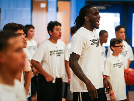 Taurean Prince cheers on a team practicing a move during a one-day basketball clinic Saturday, June 9, 2018, at Lincoln Middle School.