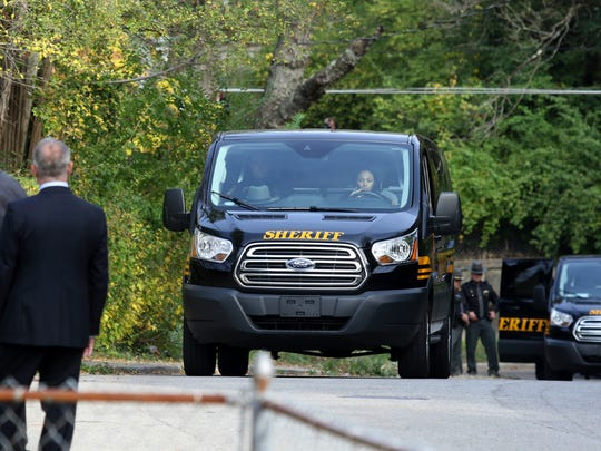 Two Hamilton County Sheriff Deputy vans with the jurors in the murder trial of former University of Cincinnati police officer Ray Tensing travel along Rice Street to the scene of the July 19, 2015 fatal shooting of Sam DuBose in Mount Auburn Tuesday November 1, 2016.