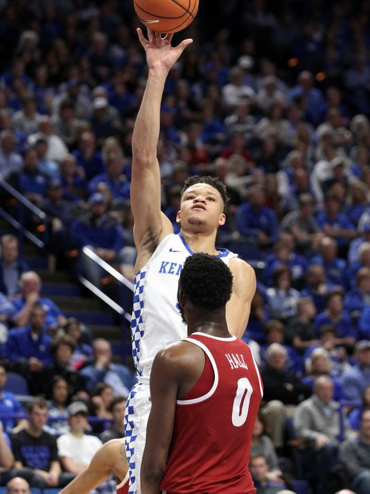 RETRANSMISSION TO CORRECT DATE - Kentucky's Kevin Knox, top, shoots over Alabama's Donta Hall (0) during the second half of an NCAA college basketball game, Saturday, Feb. 17, 2018, in Lexington, Ky. Kentucky won 81-71.(AP Photo/James Crisp)