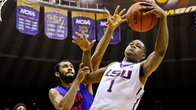 LSU Tigers forward Jarell Martin (1) rebounds over Florida Gators forward Jon Horford (21) during second half of a game at the Pete Maravich Assembly Center. LSU defeated Florida 70-63.