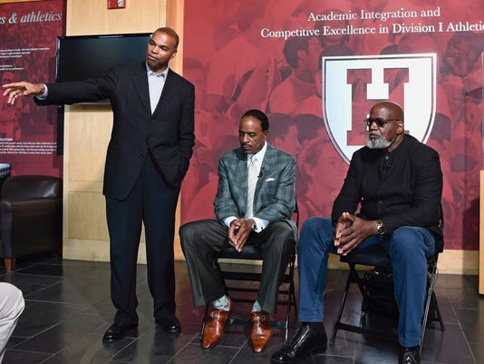 FILE -  In this Wednesday, Sept. 13, 2017, photo provoided by Harvard Athletics, Harvard basketball coach Tommy Amaker, left to right, sportscaster James Brown and civil rights activist Harry Edwards speak at a news conference at the Harvard athletic facilities in Boston. The two visitors spoke to the Crimson basketball team as part of Amaker's goal to educate his players on and off the court after the news conference. Harvard basketball coach Tommy Amaker takes his role as a teacher seriously. When he's not in the gym with his team, he might be introducing them to leaders in the financial, political or intellectual community to continue their education. (Gil Talbot/Harvard Athletics via AP)