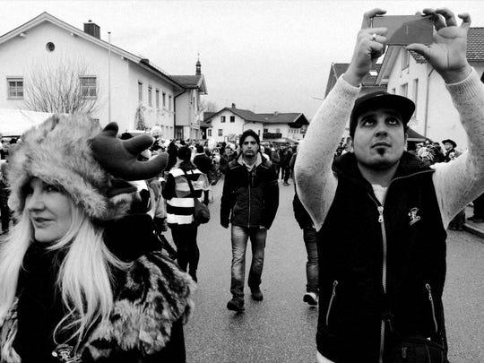 Ali Daas takes photos during Carnival in Altenmarkt,
