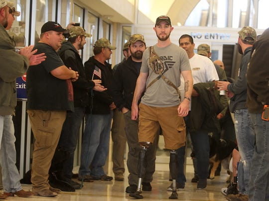 Veteran Jed Morgan, followed by a group of veterans, are greeted by a crowd as the arrive at San Angelo Airport. The veterans will be participating in the fifth annual Lone Star Warriors Outdoors hunt.