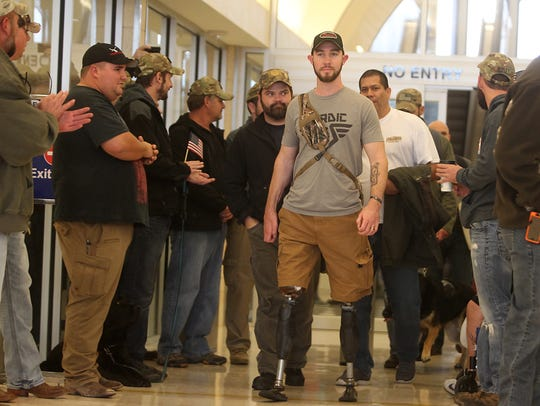 Jed Morgan and other veterans are greeted as they arrive