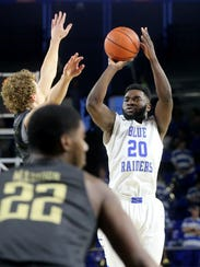 Giddy Potts (20) led the nation in three-point field