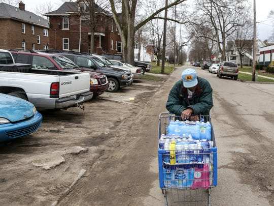 """""""I have to stop many times. I just about pass out but I've got to bring it home,"""" says Joe Willie Whiteside of his trek for water. """"If I didn't have the heart problem it wouldn't be as rough."""""""