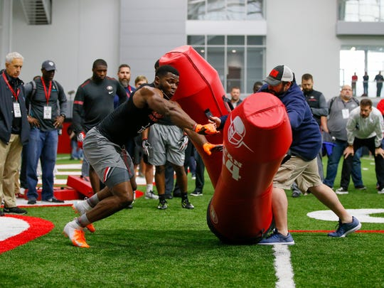 Georgia linebacker Lorenzo Carter participates in a drill with Detroit Lions coach Matt Patricia during Georgia Pro Day, March 21, 2018 in Athens.