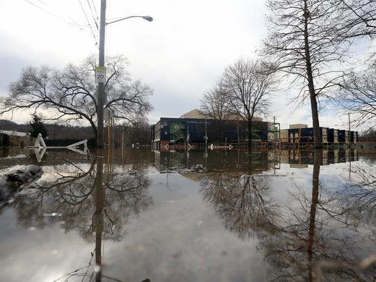Rising flood waters engulf Riverview East Academy along